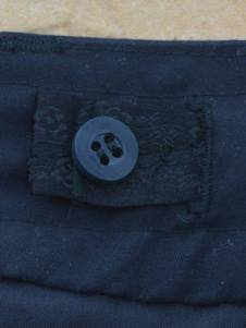 Internal drawstring button tab