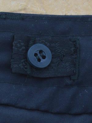 Internal drawstring button tab
