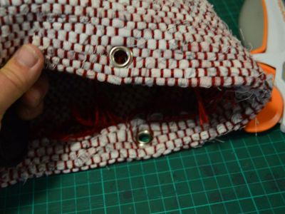 self-facing turned inside the bag. Eyelets added for the straps