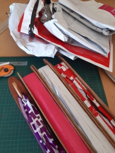 Mail satchels cut into strips ready for weaving